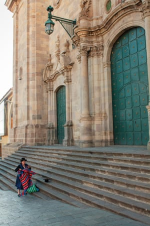 """Lady with garments and cloth walks towards the steps of a church in Potosi, Bolivia.  """"I'm from Newcastle, but I've been travelling since January 2015. Potosi is one of the world's highest cities, and while trying to catch my breath, I captured this lady (known as a cholita) in traditional dress. She uses the blanket as a kind of sling bag."""""""