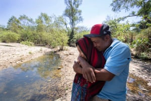Francisco Sical hugs his daughter Melissa on the banks of the drying Salamá River in their Mayan village in Guatemala. They were subjected to the Trump administration's Migrant Protection Protocols in May 2019 and spent two months in Juárez at the U.S.-Mexico border before returning home, defeated.