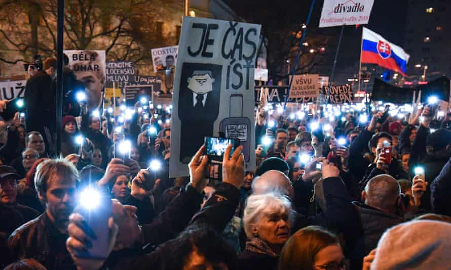 Banners are waved during Friday's mass protests across 34 cities in Slovakia.