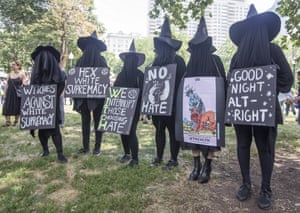Counter-protesters dressed as witches.