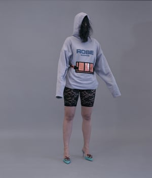 Nassia wears hoodie, £365, and waistpack, £240, by Martine Rose available at Browns. Shoes, £795, by Manolo Blahnik. Cycle shorts, stylist's own