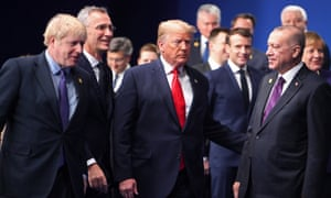 World leaders including Boris Johnson, Donald Trump and Recepy Tayyip Erdoğan gather for the family photo at the Nato summit in London on Wednesday.