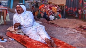 Mohammed, known to Leon McCarron as Mohammed of the Mountains, reclines on a rug, in Petra, Jordan.