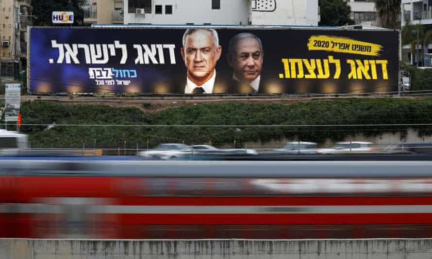 An election campaign poster depicting party leader Benny Gantz, and Israeli Prime Minister Benjamin Netanyahu, in Tel Aviv.