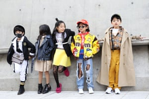 Children wait for an event during Seoul fashion week