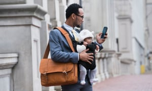 Businessman carrying a baby