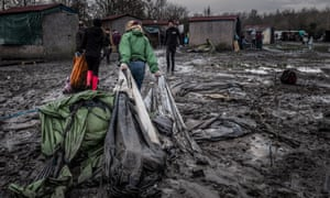 Volunteers try to clean up the camp
