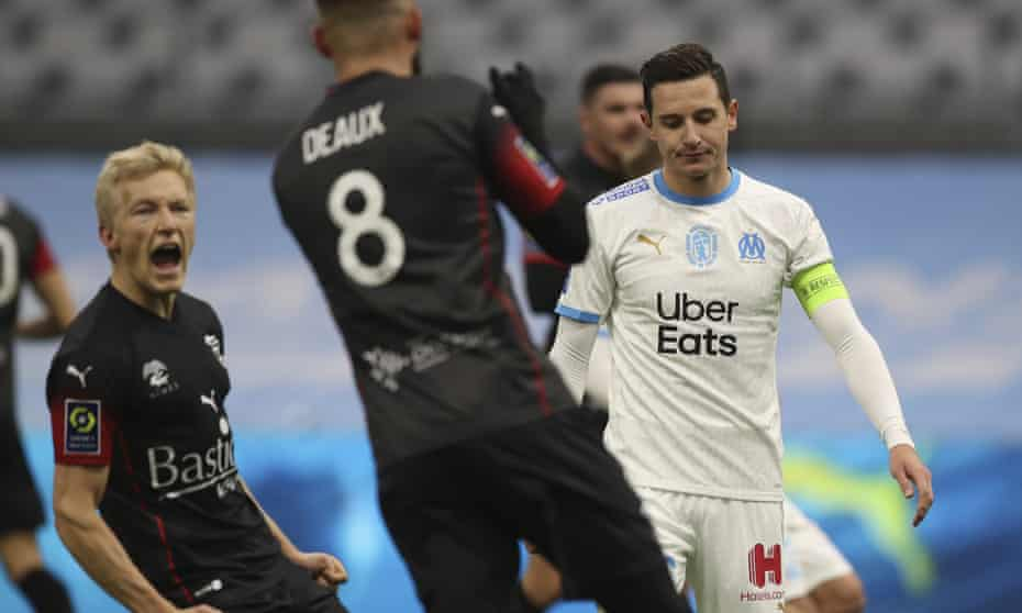 Florian Thauvin (right), who is out of contract this summer, reacts after missing a penalty against Nîmes.