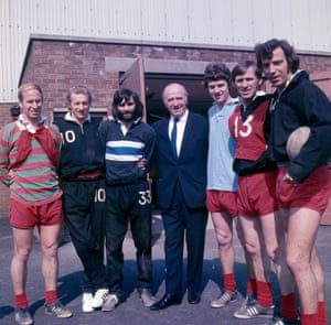 Matt Busby, centre, with the Manchester United players (left to right) Bobby Charlton, Denis Law, George Best, Brian Kidd, Pat Crerand and David Sadler at Manchester United's Cliff training ground