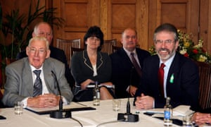 Ian Paisley and Gerry Adams around a triangular table as the Northern Ireland deal is announced in March 2007.