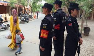 Police patrolling the Old Town in Kashgar, Xinjiang