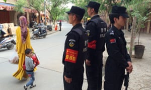 Police on patrol in Kashgar, in the Xinjiang region.