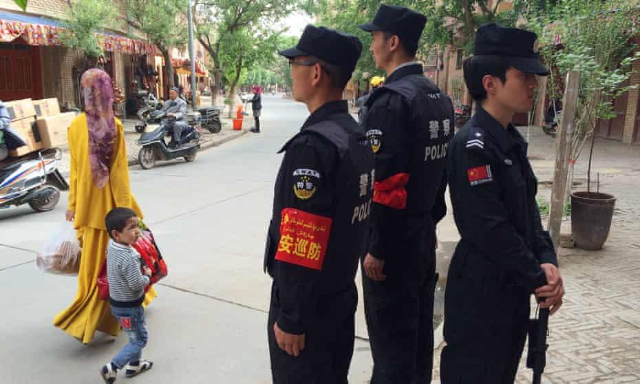 Police on patrol in Kashgar, in the Xinjiang region.