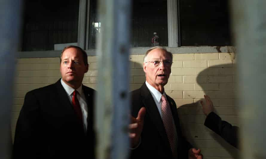 Alabama governor Robert Bentley, right, and state senator Cam Ward look through bars in a dormitory at William C Holman correctional facility in Atmore.