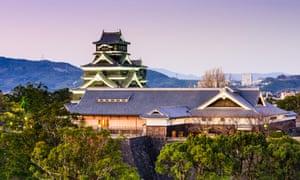 Kumamoto Castle against pink sky