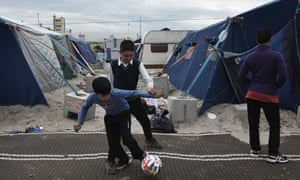 Children play in the 'jungle', Calais, in 2016; the refugee camp was torn down in October that year.