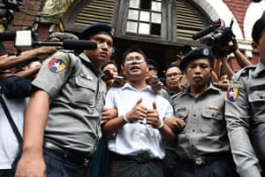 Wa Lone (centre), one of two Reuters journalists jailed in Yangon, Myanmar