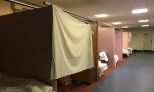 sheets between beds at Napier Barracks