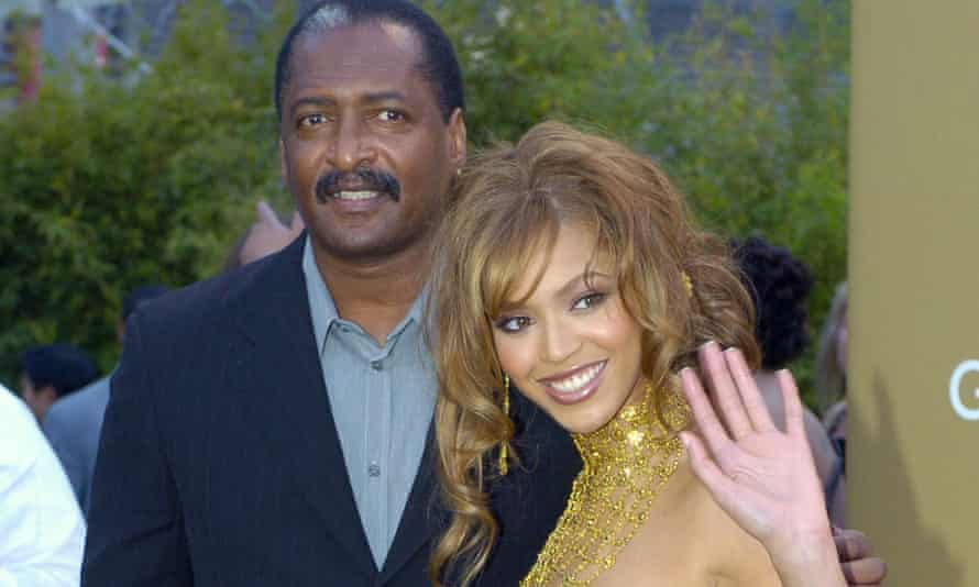 Beyonce Knowles arrives at the 46th annual Grammy Awards with her father on 8 February 2004.