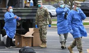 Members of the Wisconsin national guard conduct drive through testing for the coronavirus at Burlington high school.