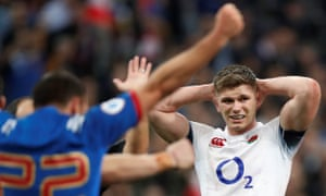 England's Owen Farrell looks dejected as France celebrate victory after the match.