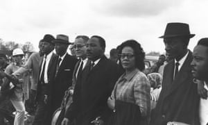 American civil rights leader Martin Luther King (1929 - 1968) (centre) with his wife Coretta Scott