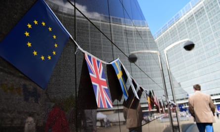 An European flag and a British flag stand next to each others outside the European Commission building, in Brussels
