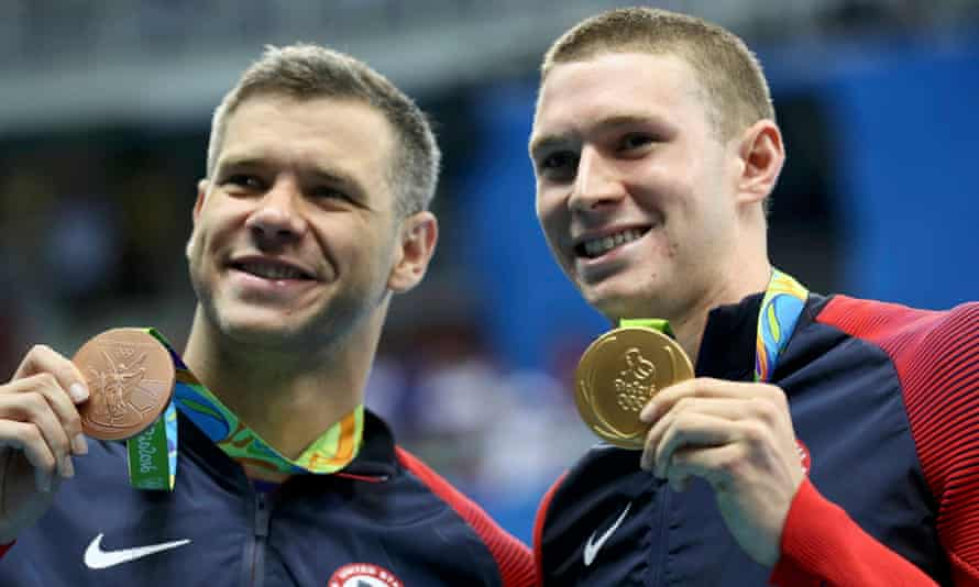Ryan Murphy (right) poses with his gold with his USA team-mate David Plummer, who won bronze