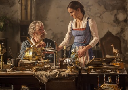 Emma Watson as Belle in the workshop with her father, played by Kevin Kline.