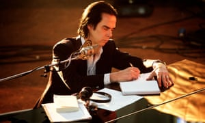 Nick Cave writing in notebook