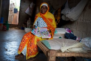 The monthly payment allowed Asherjuma Ama to buy these school books for her grandson