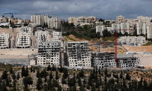 Israeli construction cranes and excavators at a building site of the Jewish settlement of Neve Yaakov, in the northern area of East Jerusalem.