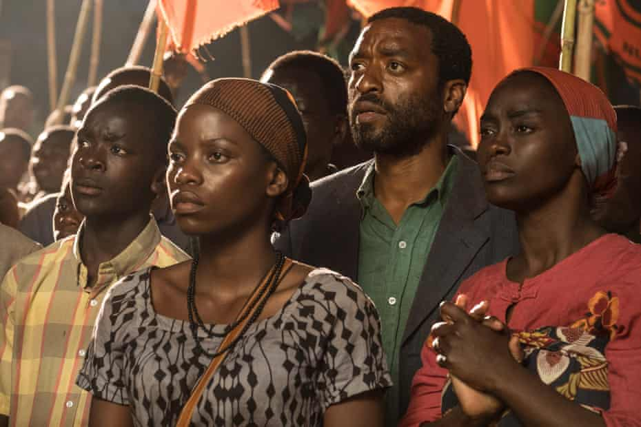 Maxwell Simba, Lily Banda, Chiwetel Ejiofor and Aïssa Maïga in The Boy Who Harnessed the Wind
