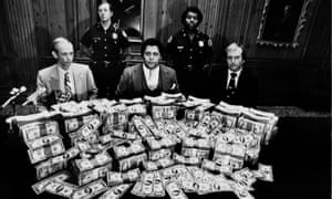 Maynard JacksonAtlanta Mayor Maynard Jackson, center, is flanked by security guards in his office as he poses with $100,000 reward money offered for clues to the deaths of 17 Atlanta children, Feb. 21, 1981.(AP Photo)