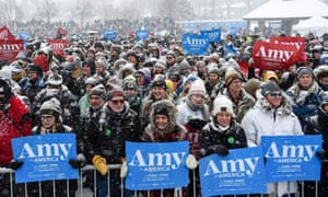 Supporters wait in a snowfall to see Democratic Senator of Minnesota Amy Klobuchar announce that she is running for US president in Minneapolis on Sunday.
