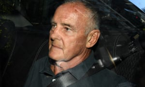 Chris Dawson arrives in Sydney after being extradited from the Gold Coast