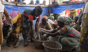 Refugees from Central African Republic fashion sawdust and clay into briquettes for burning at the Mbilé refugee camp in east Cameroon