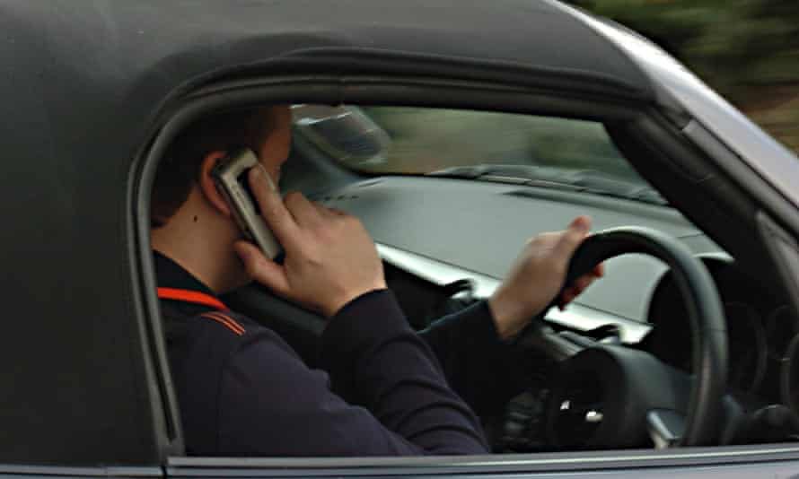 A driver using a mobile phone
