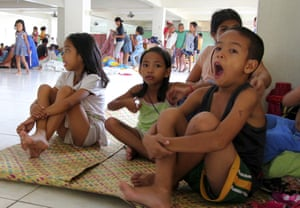 Residents at an evacuation centre in Legazpi city, central Philippines.