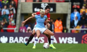 Steph Houghton holds off Jessica Sigsworth in City's recent derby defeat by United in the Continental Cup