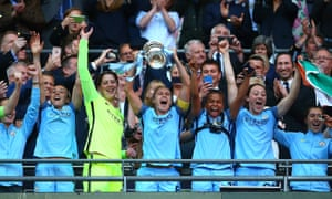 Steph Houghton of Manchester City lifts the trophy.