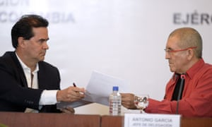 The head negotiators of the Colombian government and the country's ELN left-wing guerrilla, Frank Pearl, left, and Antonio García respectively, begin peace negotiations in Caracas on Wednesday.