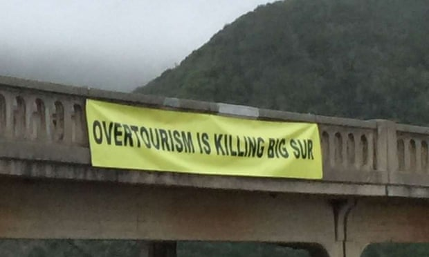 A group called Take Back Big Sur hung the banner, which was taken down after several hours.