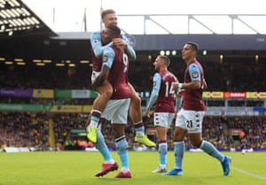Grealish congratulates Wesley on his second goal.