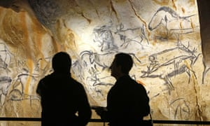FILE - A March 6, 2015 photo from files showing visitors in the life size replica of Grotte Chauvet, or Chauvet cave, in Vallon Pont d Arc, near Bollene, southern France. Since most modern humans will never get to see the masterpieces in what is widely known as the Chauvet Cave, scientists, artists and the French government have spent 56 million euros (about $60 million) and several years creating the next best thing: A near-exact replica of the cave a few hundred meters (yards) away, including more than 400 paintings of horses, bears, rhinoceros and mammoths, hand prints and carvings. (AP Photo/Claude Paris, File)