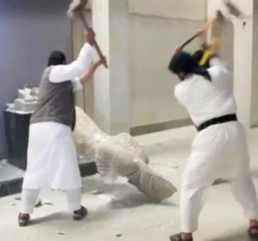Isis members use sledgehammers to destroy a statue at Mosul museum in Iraq.