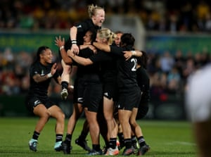 New Zealand players celebrate their victory at the final whistle.
