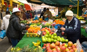 A market scene: for 70 years, people of all races in Britain have shared the same economic struggles