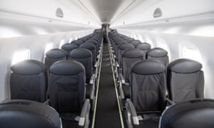 The cabin of an almost empty British Airways passenger plane