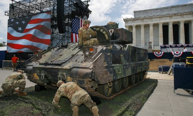 An army soldier hops out of a Bradley fighting vehicle after moving it into place by the Lincoln Memorial in Washington DC, on 3 July.